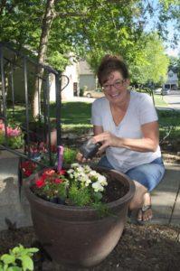 Brenda planting flower pots